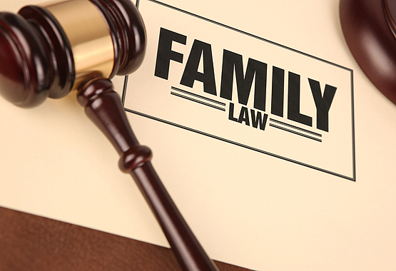 gavel next to a sign of family law office