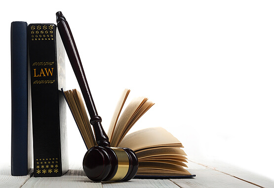 law books and a gavel sitting on a table