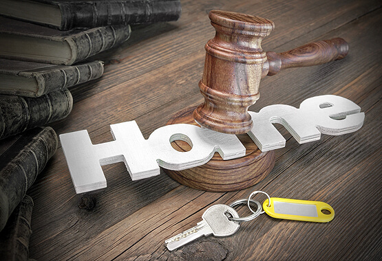 gavel tapping on the word home