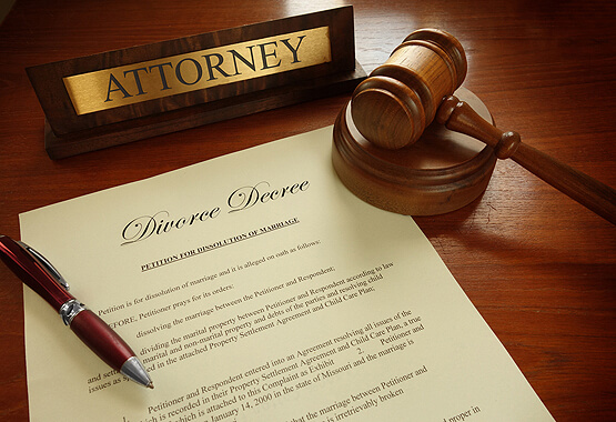 attorney nameplate wooden gavel and divorce contract on a table