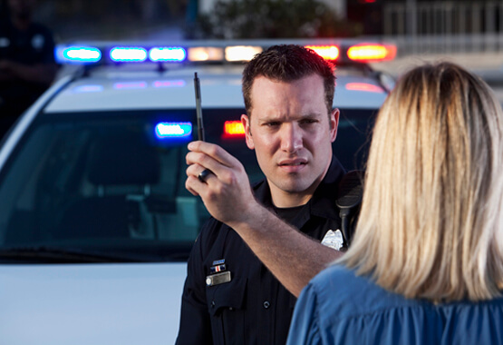 police officer checking for DUI