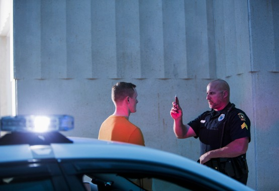 A man being given a sobriety test by a police officer, soon to need a DUI Lawyer in East Peoria IL