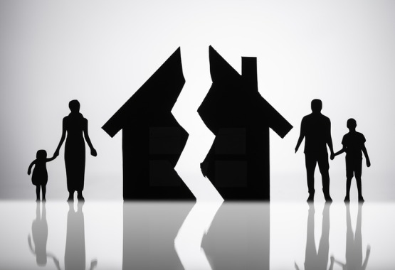 A silhouette of a family on either side of a broken house, representing Family Law in East Peoria IL