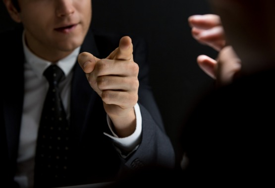A Criminal Defense Lawyer in East Peoria IL speaking with a prosecutor