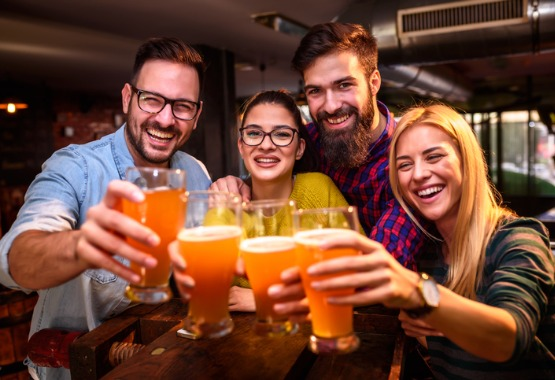group of adults drinking beer at the bar